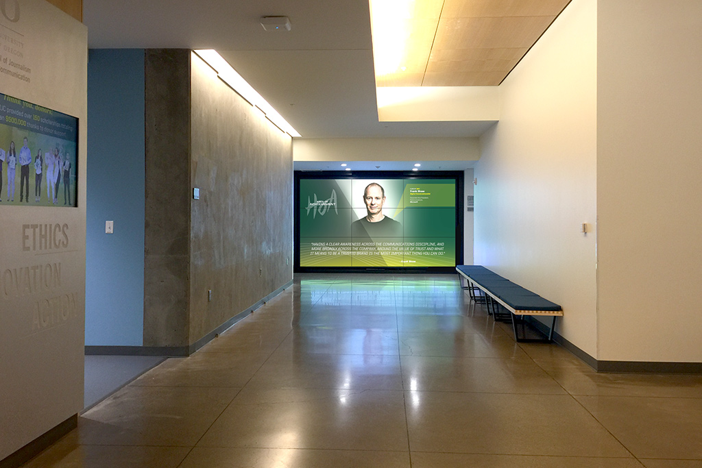 Looking down hallway at Hall of Achievement video wall