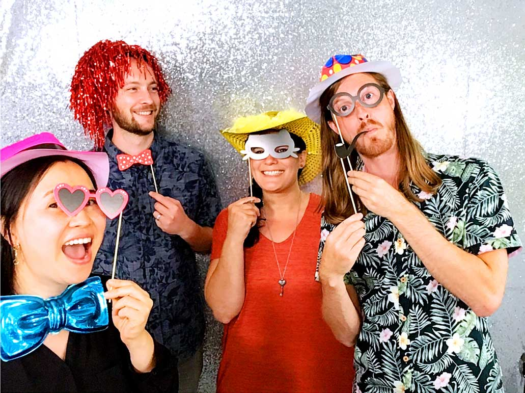 Serenity team members taking a silly photo in photo booth